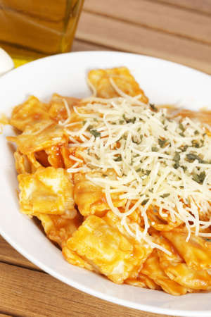 Freshly cooked plate of italian pasta with cheese and tomato, just for eating. Shallow depth of field photo