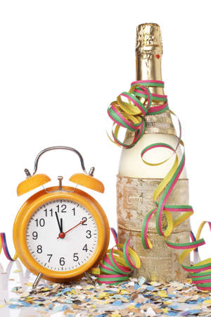 Waiting the New Year with champagne bottle and clock. Shallow depth of field Stock Photo - 3890749