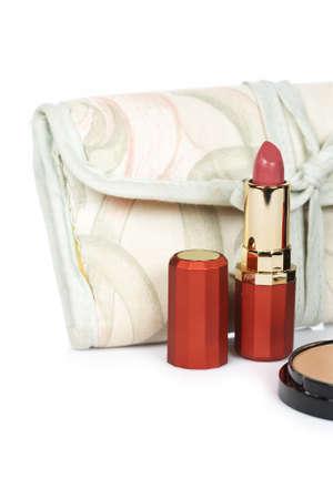 gift spending: Lipstick and handbag isolated on white background