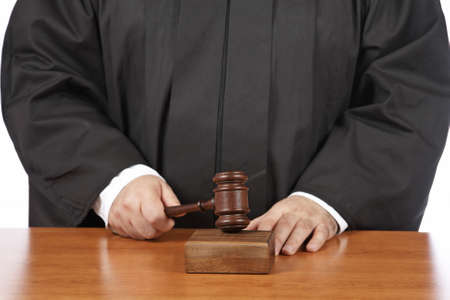 A male judge in a courtroom striking the gavel. Shallow depth of field Stock Photo - 4141504