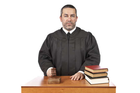sentence: A male judge in a courtroom striking the gavel and pronounces sentence Stock Photo