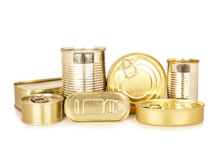 Assortment of golden food tin can reflected on white background