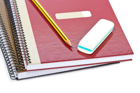 Pencil and eraser on a two notebooks with soft shadow on white background. Shallow depth of field Stock Photo - 4240063