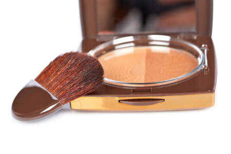 Detail of assortment of makeups reflected on white background. Shallow depth of field photo
