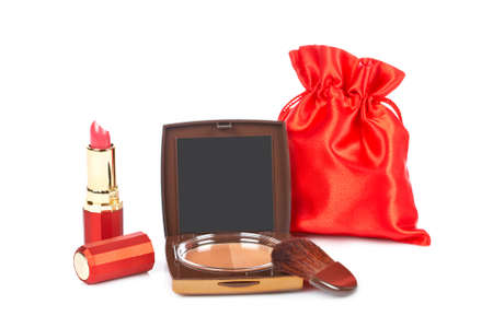 makeups: Assortment of makeups reflected on white background. Shallow depth of field Stock Photo