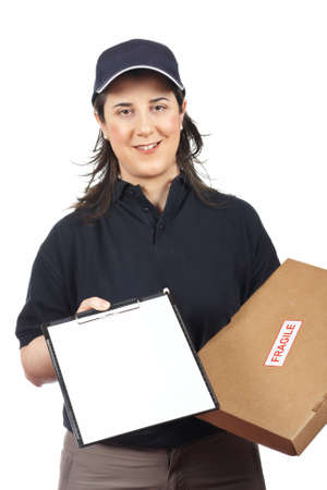 Courier woman delivering a parcel fragile and holding a clipboard for a signature photo