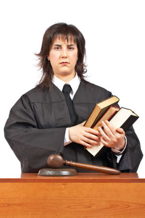Angry female judge holding the books. Shallow depth of field photo