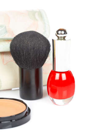makeups: Detail of assortment of makeups reflected on white background. Shallow depth of field Stock Photo