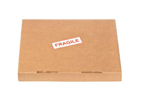 Fragile on cardboard box,  isolated on white background photo