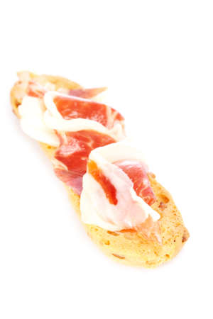 Slices of tasty spanish ham on white background. Shallow depth of field photo