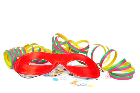 conceal: Red mask, ribbons and confetti on white background. Shallow depth of field Stock Photo