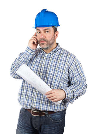 journeyman: Construction worker holding blueprints and talking with cell phone, isolated on a white background