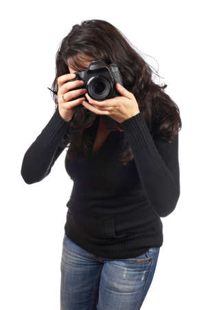 Young woman photographer holding a photo camera, isolated over white background  photo