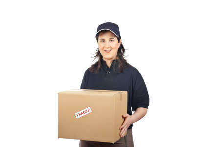 Courier woman delivering a package fragile on white background Stock Photo - 4558236