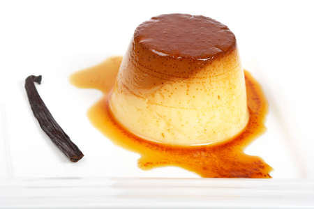 flan: Vanilla cream caramel dessert on white dish. Shallow depth of field