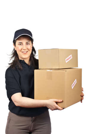 Courier woman delivering a parcels fragile isolated on white background Stock Photo - 4720020