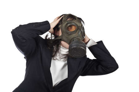 Business woman in gas mask isolated on white background photo