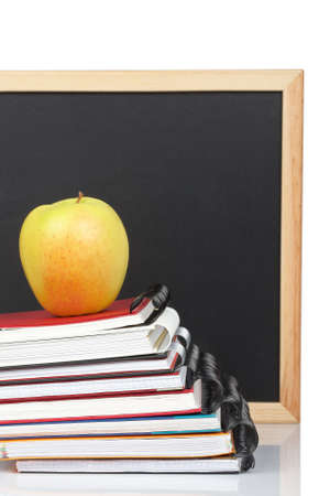 Some notebooks and yellow apple. Shallow depth of field Stock Photo - 4820648
