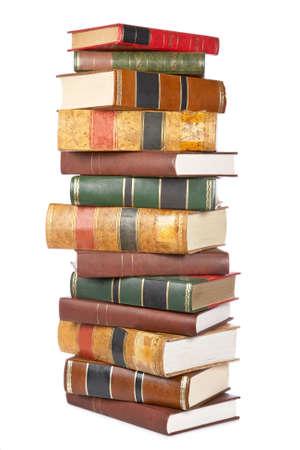 in a pile: Pila de libros aislados en el fondo blanco