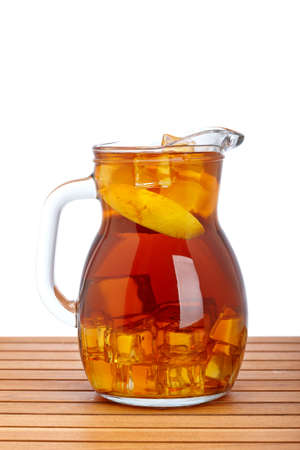 pitcher: Ice tea pitcher with lemon and icecubes on wooden background