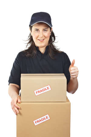 Courier woman delivering a parcels fragile isolated on white background Stock Photo - 4890293