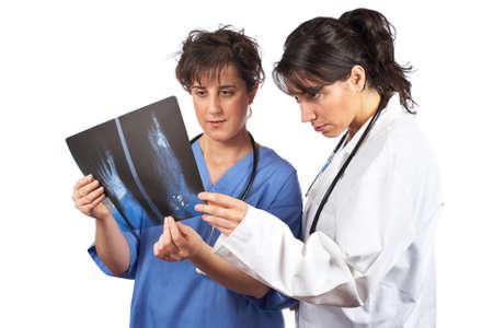 Two female doctors examining x-ray isolated on white background  photo