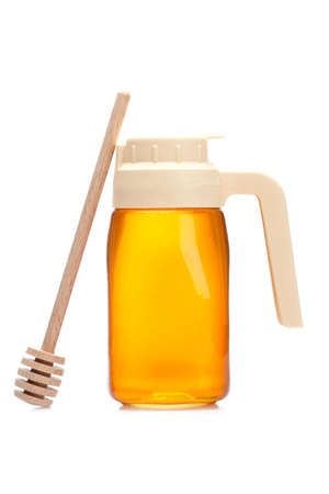 reflect: Honey pitcher and wooden drizzler, reflected on white background Stock Photo