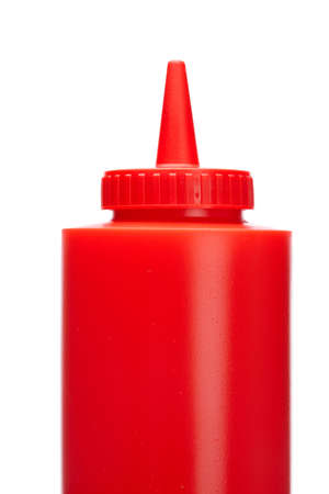 squirting ketchup: Ketchup bottle isolated on a white background Stock Photo