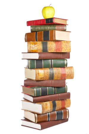 stacked books: Apple on the pile of books isolated isolated on white background Stock Photo
