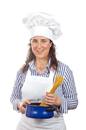introduces: Attractive cook woman who introduces a spaghetti uncooked in the blue pan
