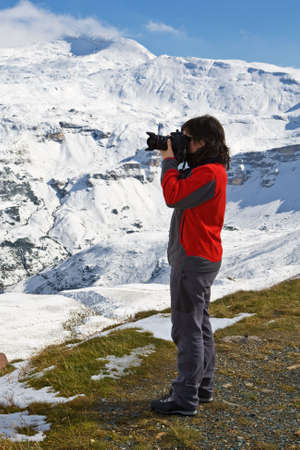 tauern: Woman photographer in Grossglockner, National Park Hohe Tauern, Austria