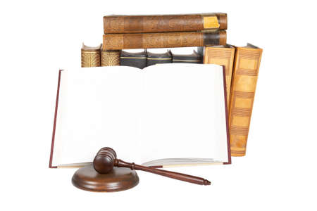 judicial proceeding: Wooden gavel from the court and law books isolated on white background. Shallow depth of field