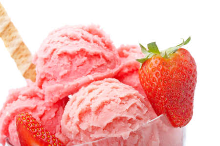 splurge: Delicious strawberry ice cream in glass bowl isolated on white background. Shallow depth of field Stock Photo