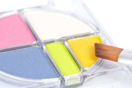 makeups: Detail of assortment of makeups on white background. Shallow depth of field