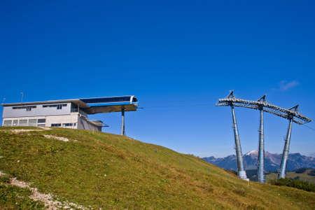 Station and ski lift tower under high mountains, Gosau Austria photo