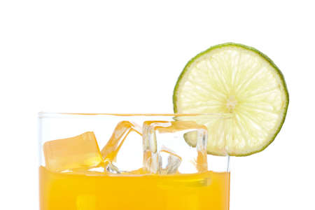 A glass of orange juice with a lime slice , isolated on white background photo