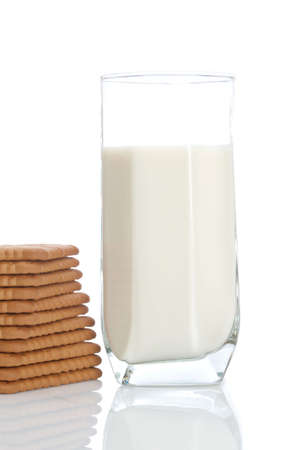 lactation: A stack of cookies and fresh milk tumbler. Shallow depth of field