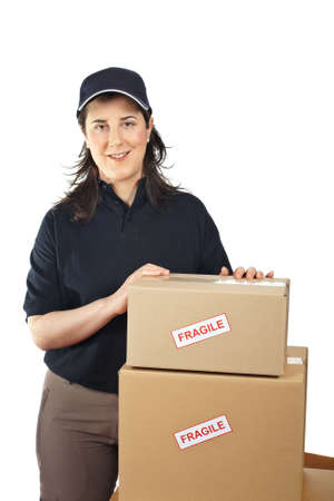 Courier woman delivering a parcels fragile isolated on white background Stock Photo - 5171927