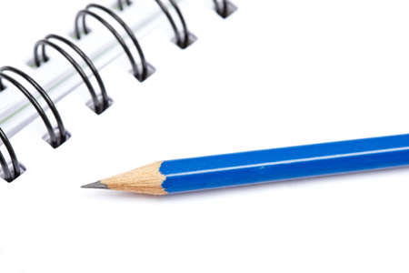Pencil on a one notebook with soft shadow on white background. Shallow depth of field Stock Photo - 5198906