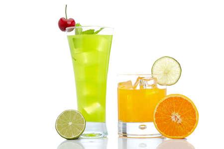 A glass of fresh kiwi and orange juice reflected on white background Stock Photo