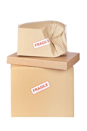 Damaged cardboard box,  isolated on white background photo