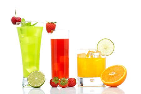 A glass of fresh strawberry, orange and kiwi juice reflected on white background