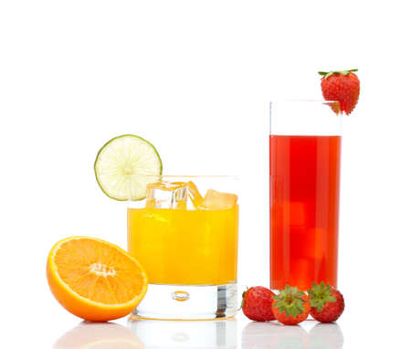 A glass of orange juice with a lime slice and strawberry juice, reflected on white background photo