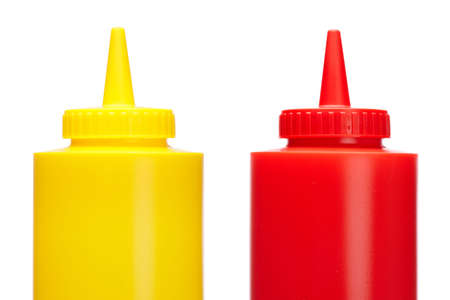 squirting ketchup: Ketchup and mustard bottles isolated on a white background