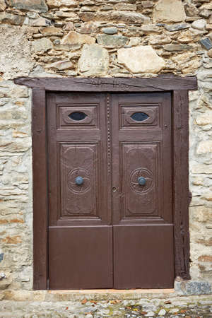 Beautiful antique wooden door on an old house photo