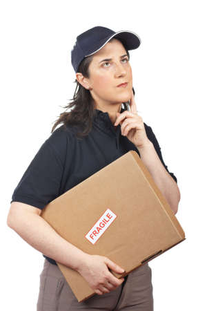 Courier woman holding a package fragile on white background Stock Photo - 5908992