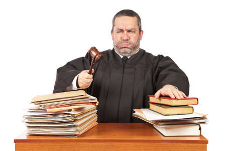 adjourned: Angry male judge in a courtroom striking the gavel and pronounces sentence