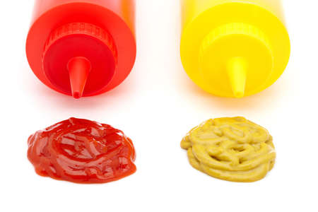squirting ketchup: Ketchup and mustard bottles with soft shadow on a white background Stock Photo