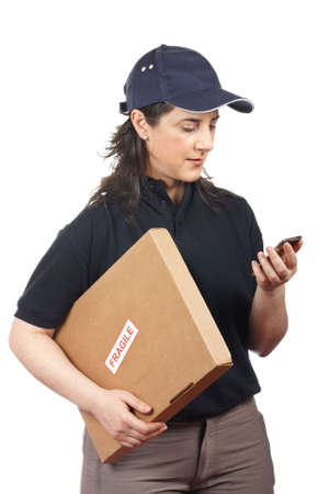 Courier woman delivering a package fragile on white background Stock Photo - 6254856