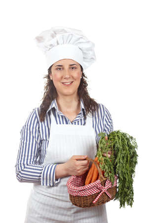 Cook woman and deliciousness gesture and holding a bunch of carrots isolated on white background  photo